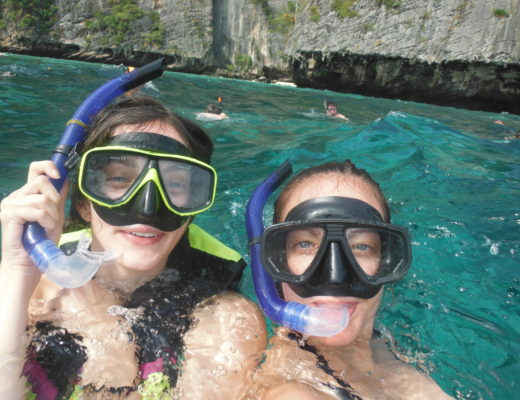 Two girls snorkeling on a budget trip in SEA