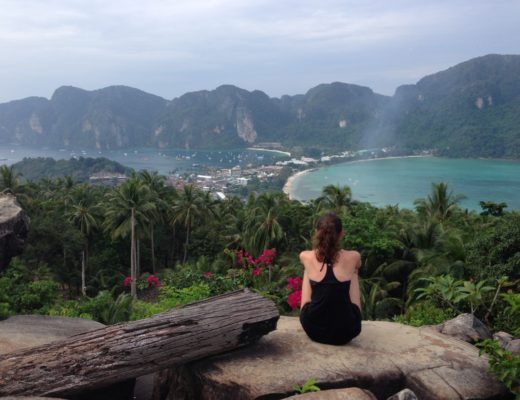 Girl sitting on mountaintop in Koh Phi Phi, Thailand