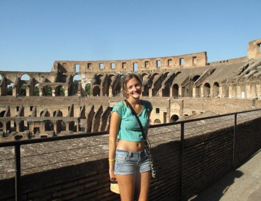 Girl in front of colosseum in Rome, Italy