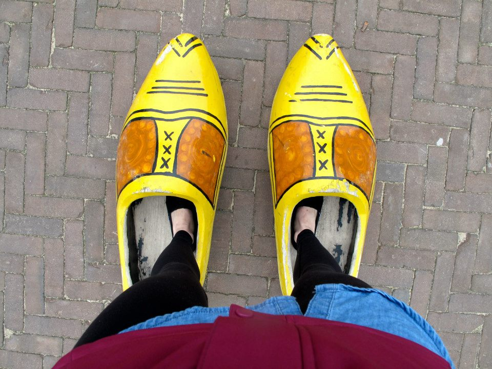 Feet in giant clogs on a solo trip through Amsterdam