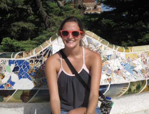 Girl sitting in Parc Guell in Barcelona