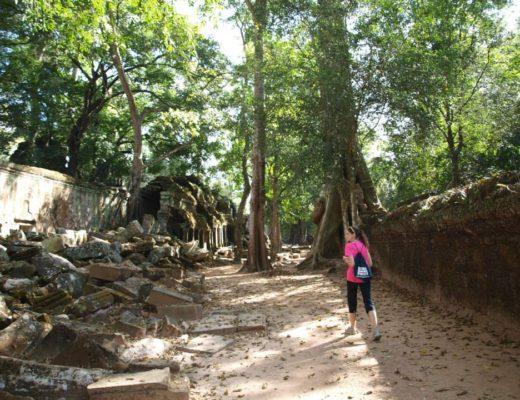 Girl walking in Angkor Temples in Cambodia