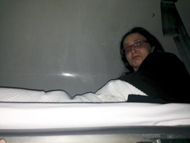 Me on my tiny top bunk.