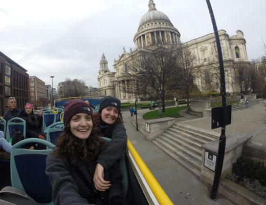 Girls on top of double decker bus in London