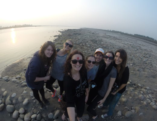Group of girls taking a selfie on the banks of a river in Nepal