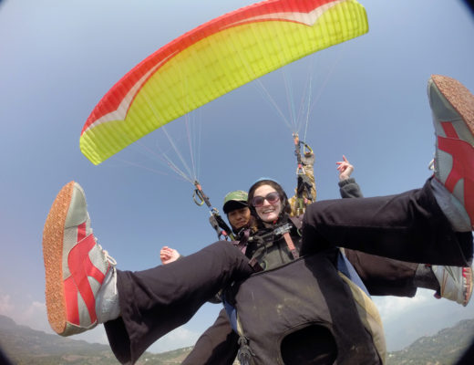 Girl paragliding in Nepal