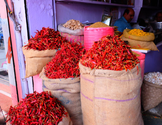 Bags of chili peppers in the street markets of India