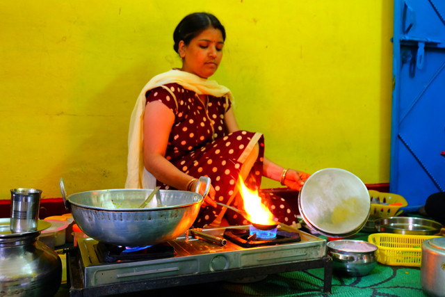 Rajni giving tourists a cooking lesson in her home in India