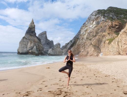 Girl doing yoga on beach in Cascais