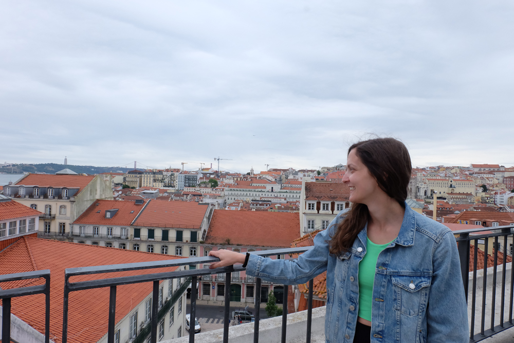 Girl looking out over the city of Lisbon, Portugal.