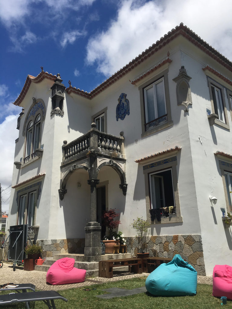 Salty Pelican Surf & Yoga Hostel was an absolute amazing vacation experience while in Portugal. Pictured here is the exterior.