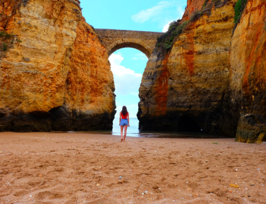 Me on trip to Portugal on Student Beach in Lagos walking towards arch