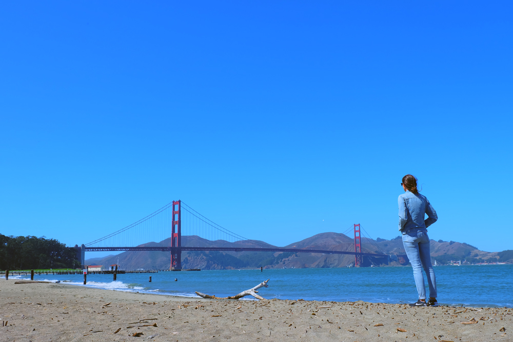 Girl staring out at the Golden Gate Bridge in San Francisco.
