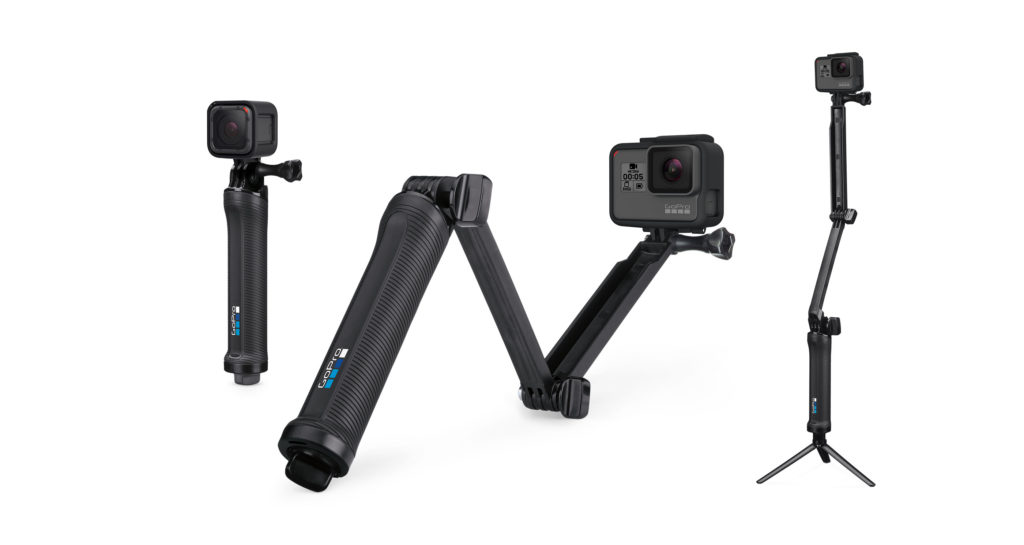 Best adventure camera for travel, GoPro, on a convenient fold-out selfie stick.