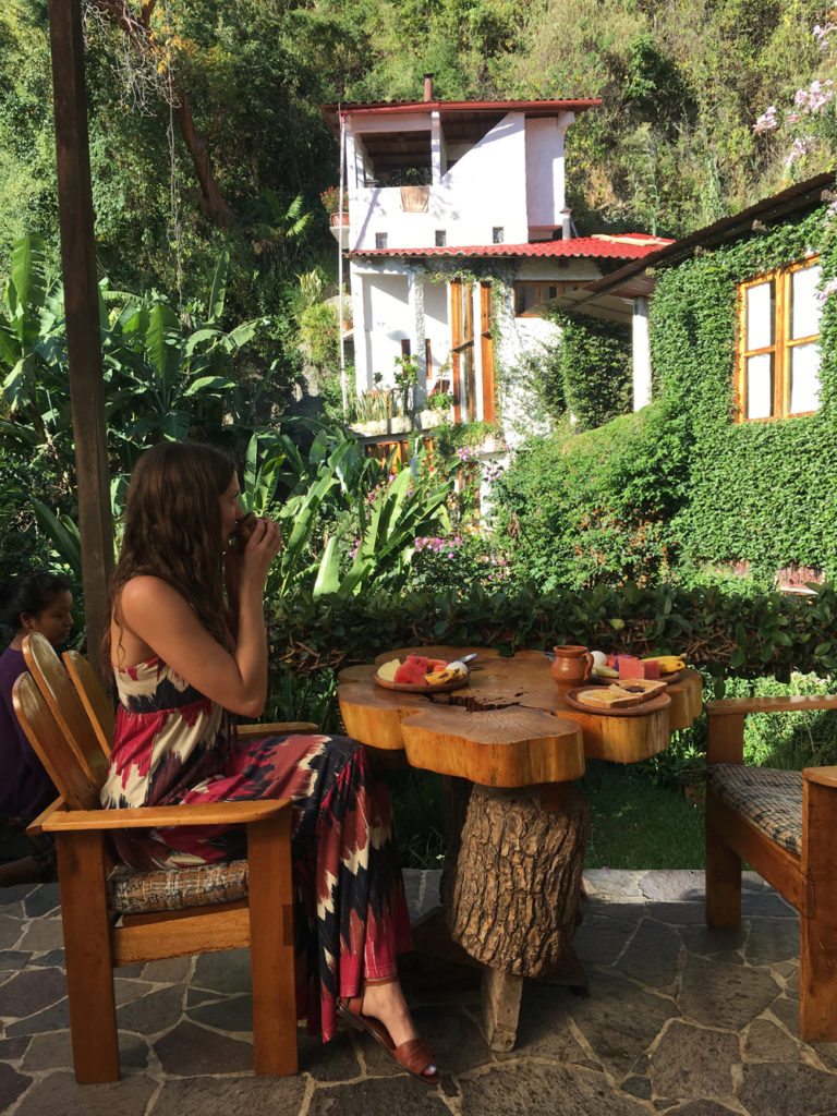 Lauren enjoying breakfast and a view at the best place to stay in Lake Atitlan, Lush