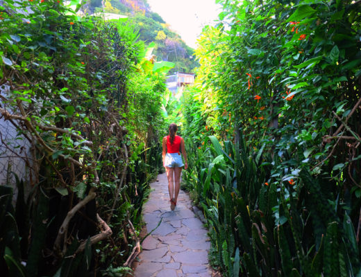 Lauren walking down a lush, green path at the best place to stay in Lake Atitlan, Lush