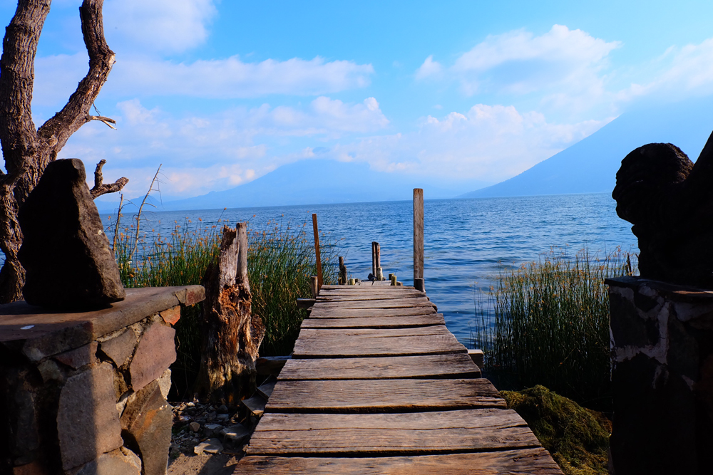 A wooden dock leading out to Lake Atitlan in Guatemala