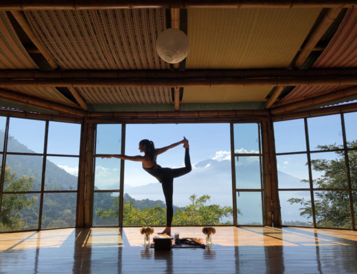 Girl in a beautiful yoga studio overlooking gorgeous scenary
