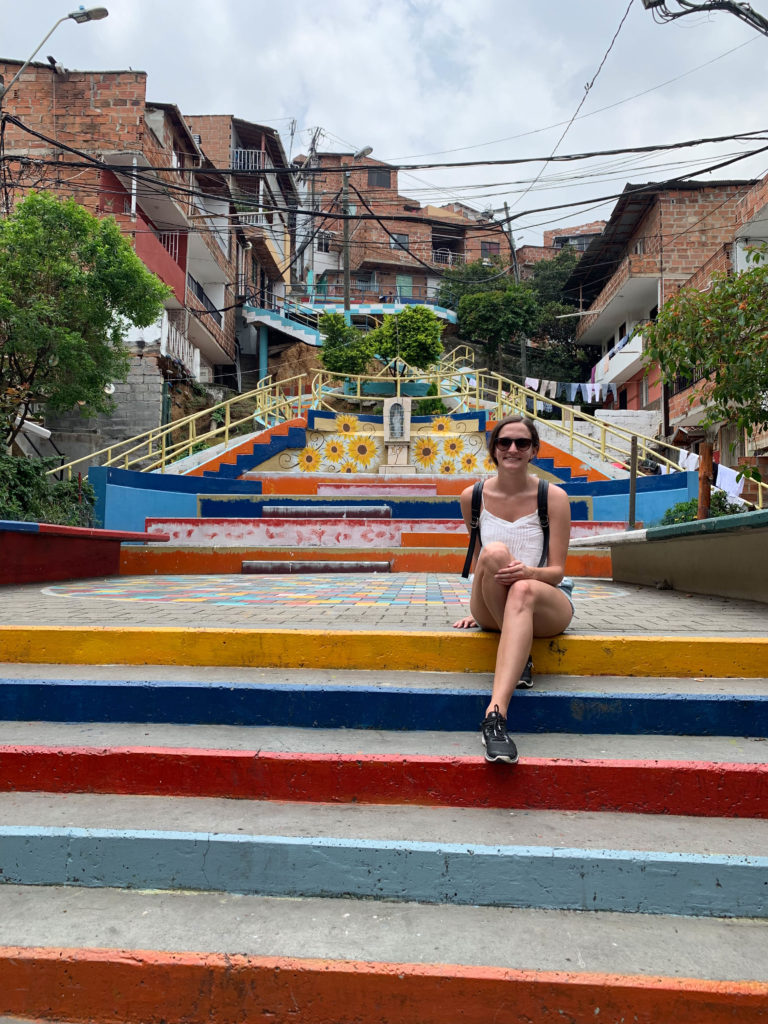 Lauren in Comuna 13, a neighbourhood that is a must-visit in Medellin, Colombia.