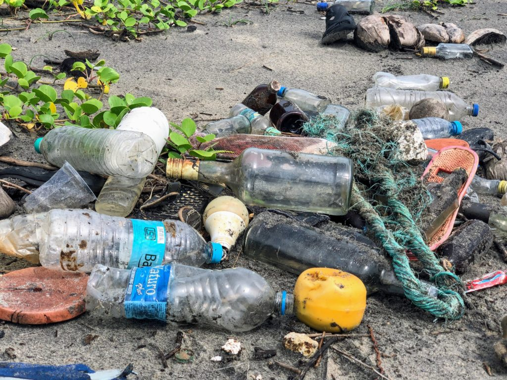 Garbage, and other single use products washed up on a beach.