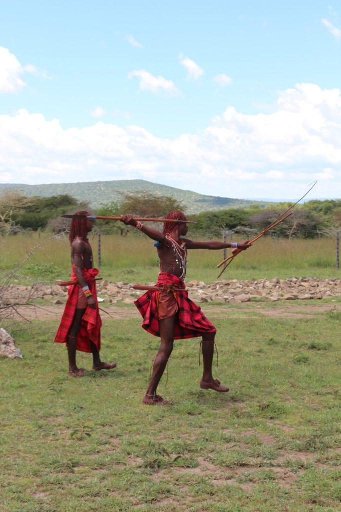 A warrior I met on my Maasai Mara safari shooting an arrow.