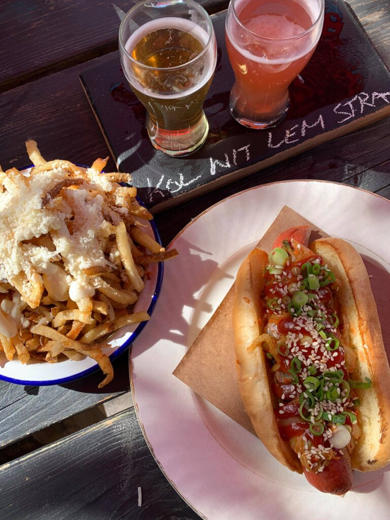 A hotdog and fries with a flight of beer at Midtown Brewery in Prince Edward County