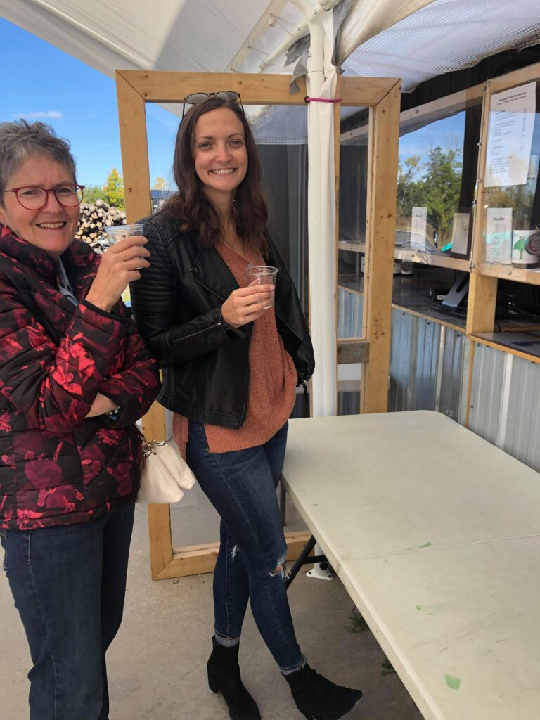 My mom and I sampling wine at a local winery in PEC