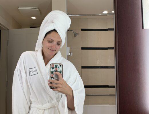 Girl in robe in mirror at St. Regis